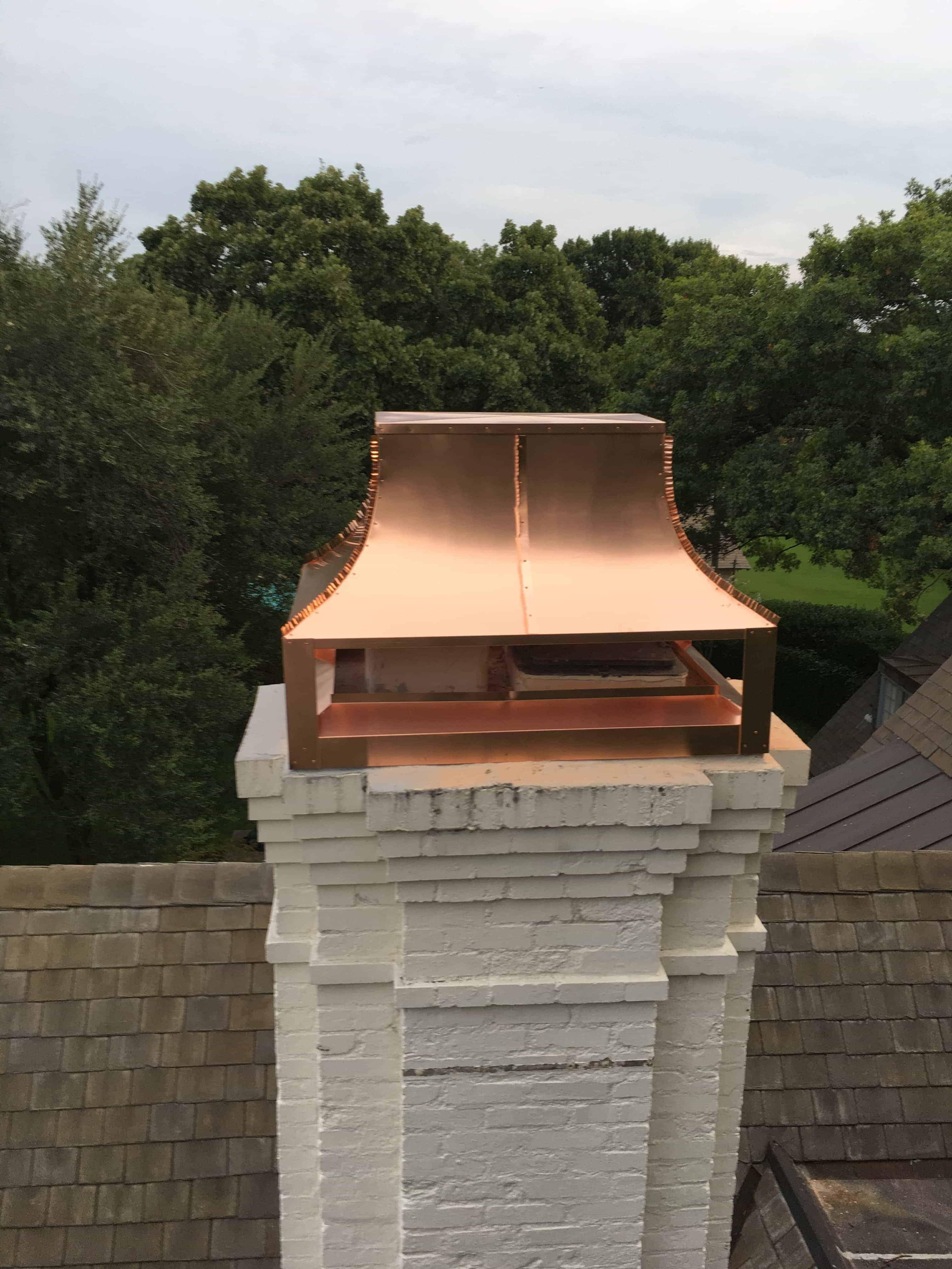Copper Hayes Chimney Cap Installed on White Brick