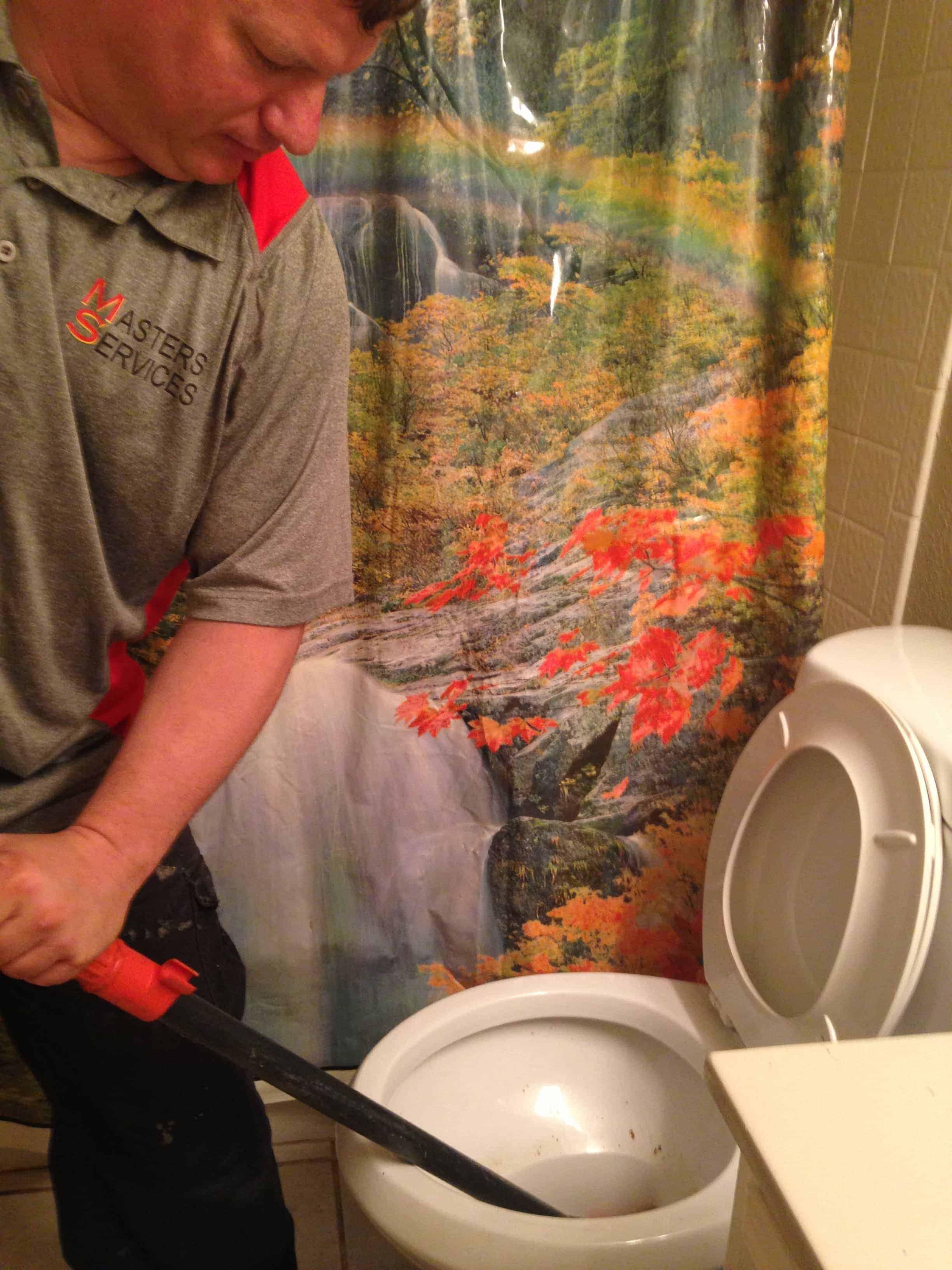 Employee During a Plumbing Job